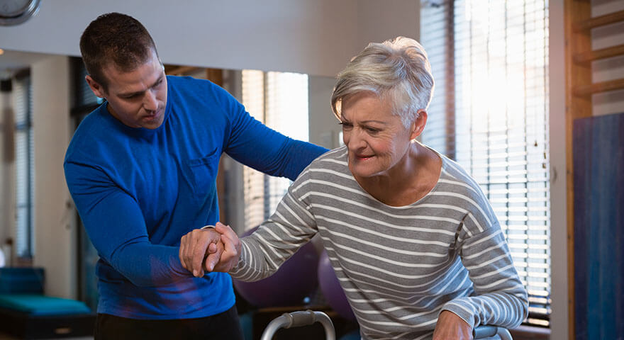 Intro to stroke rehab - woman with physical therapist